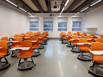 Room 1.3 Lister Teaching and Learning Centre, classroom with chairs with writing tablets.